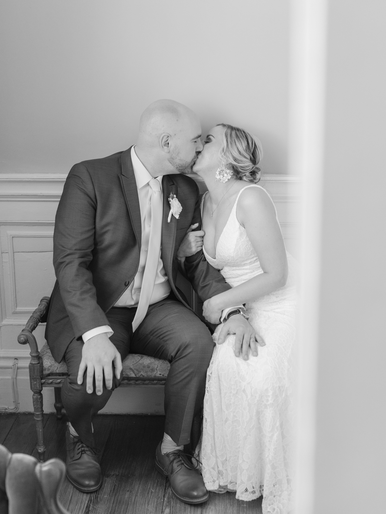 bride and groom sitting kissing