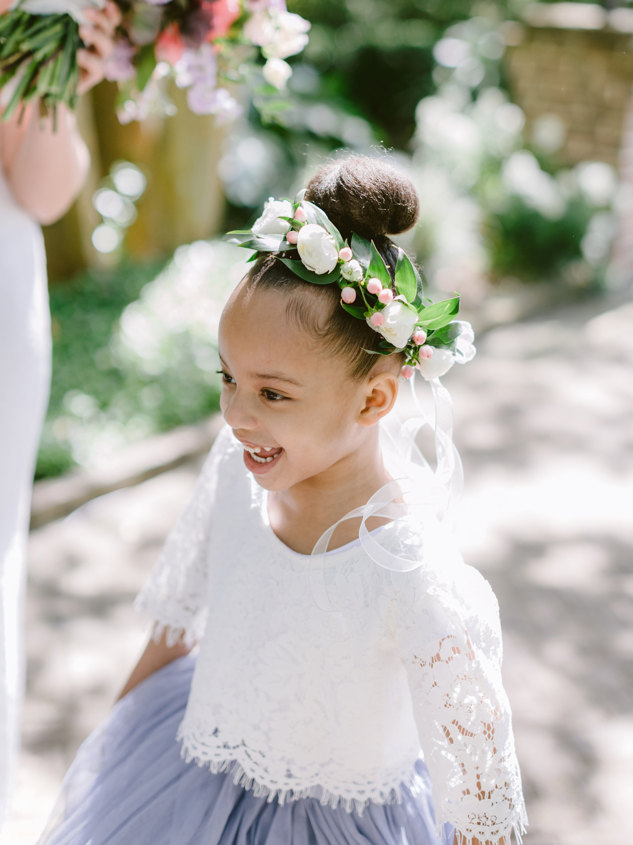 flower girl with flower crown smiling