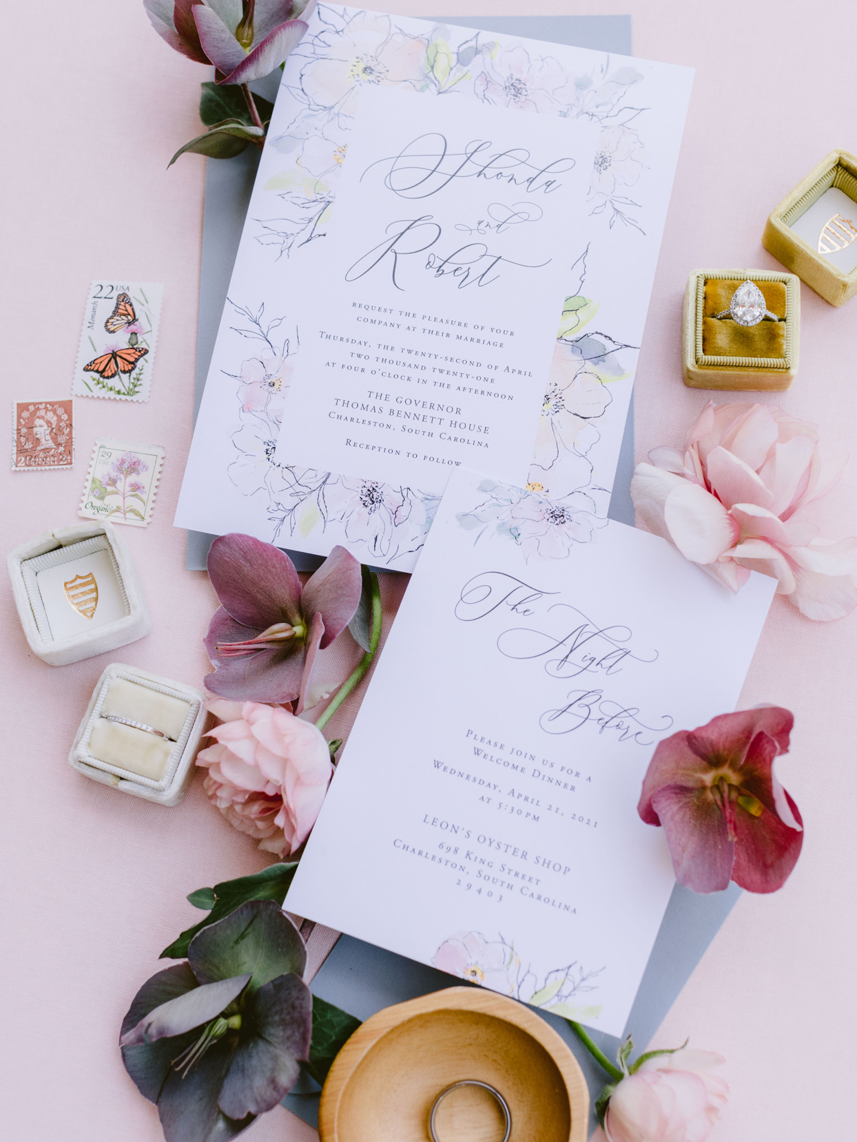wedding stationery suite with watercolor blooms framing traditional script