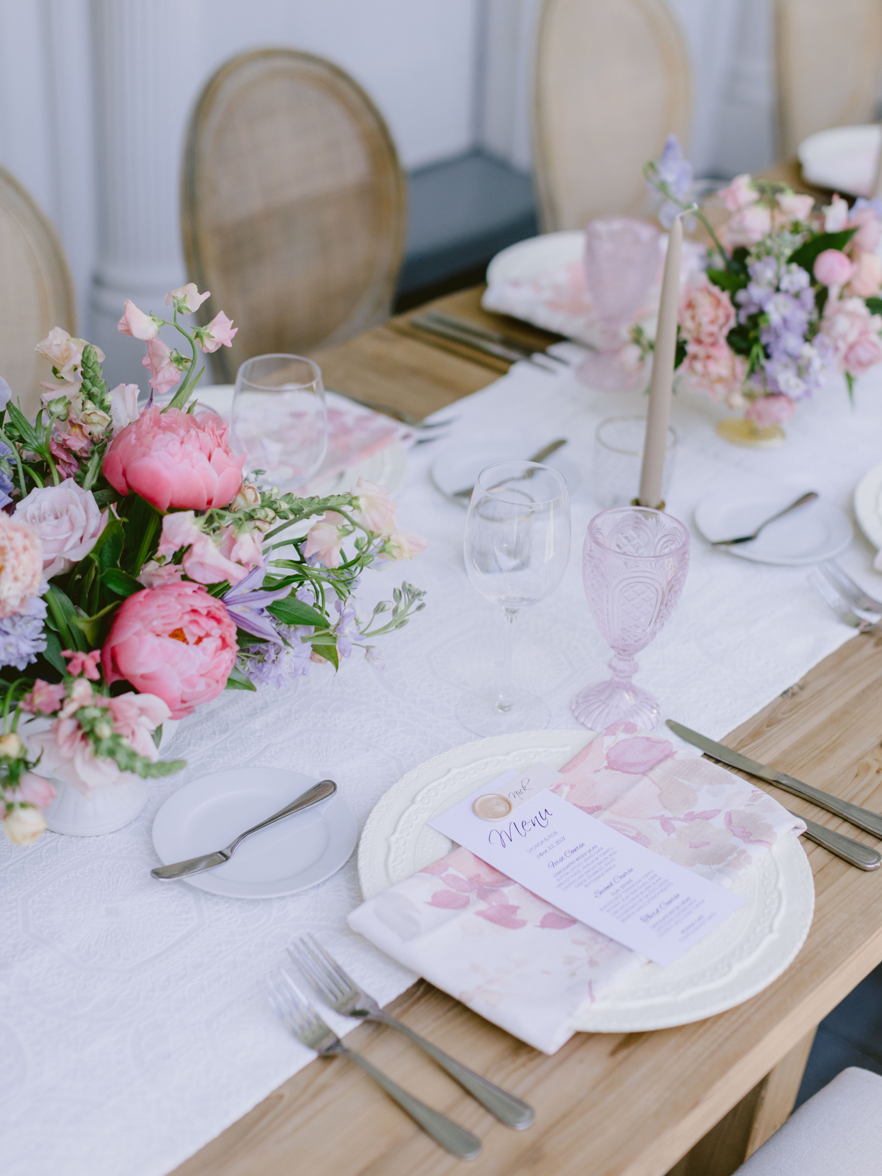 place setting menus with personalized wax seals and pink name cards