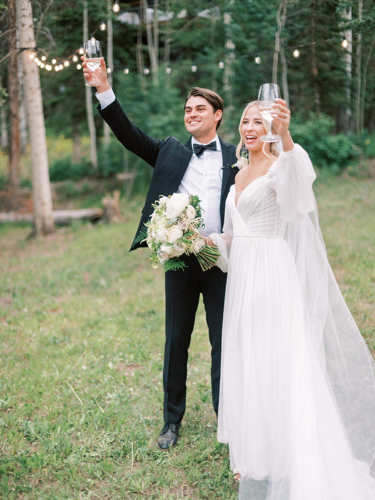bride and groom toasting to guest