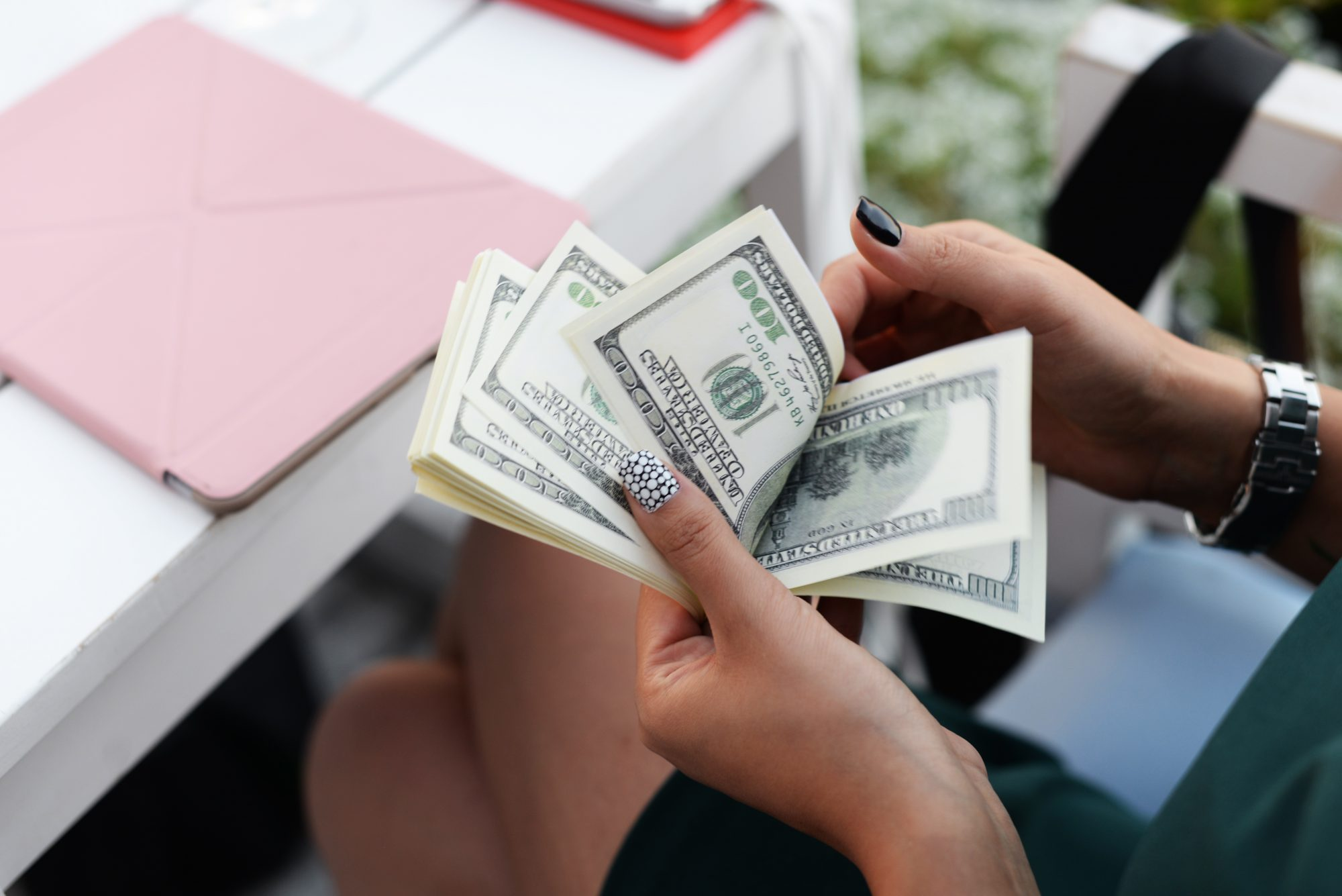 business woman county money at table