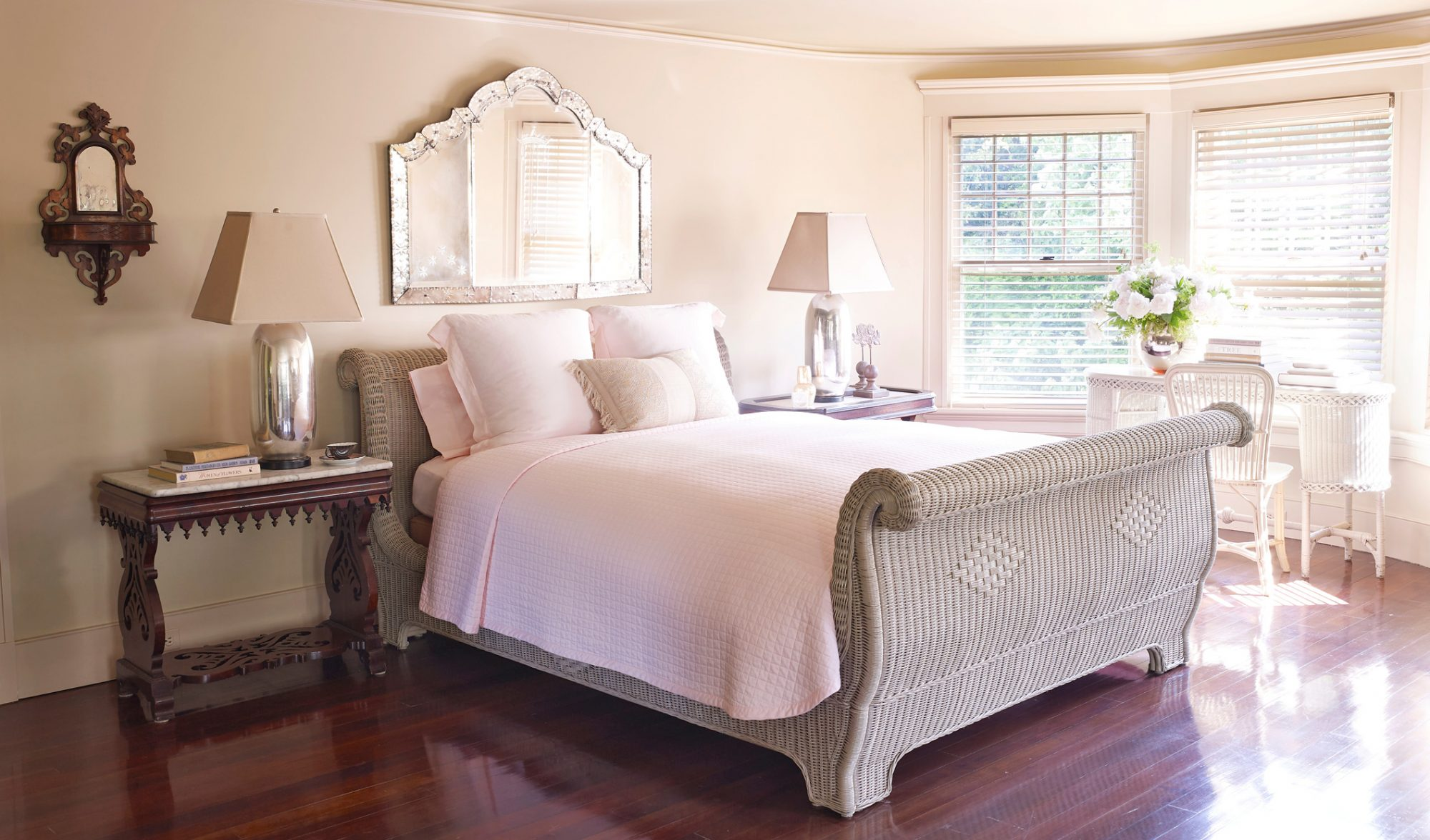 bedroom with wicker bed and writing desk