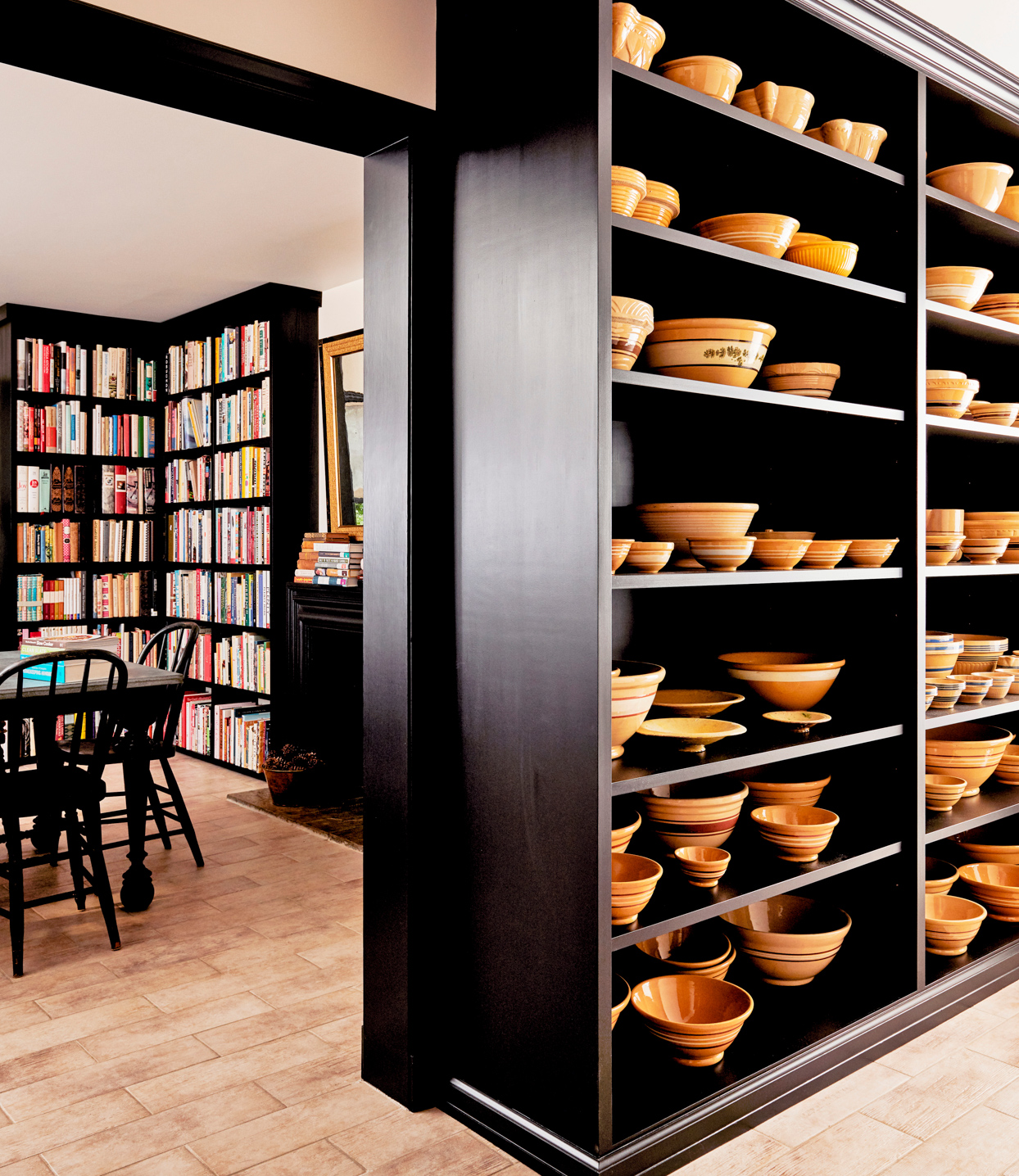 black shelves lined with yellow dishware