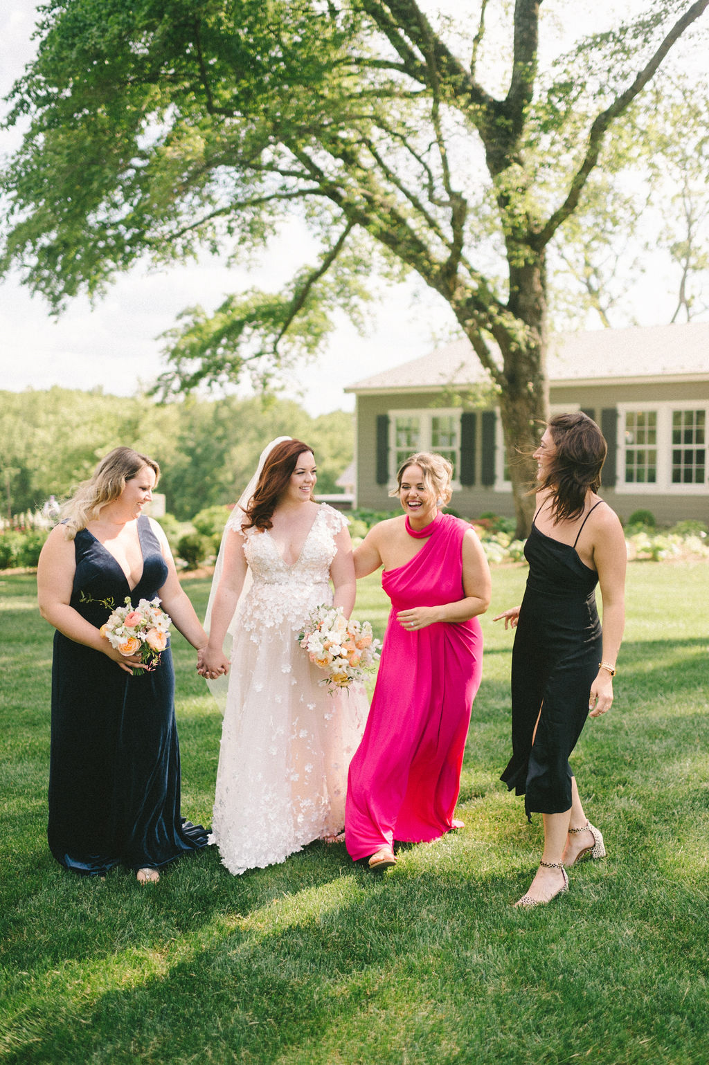 bride and bridesmaids in assorted color dresses