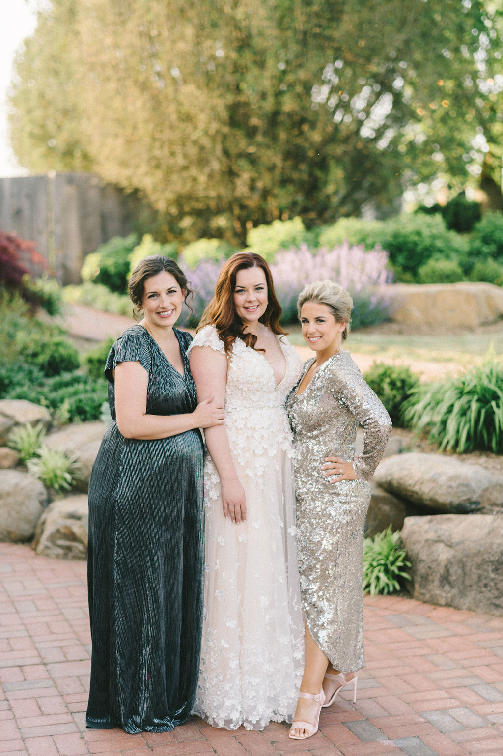 bride and friends in shimmering dresses portrait