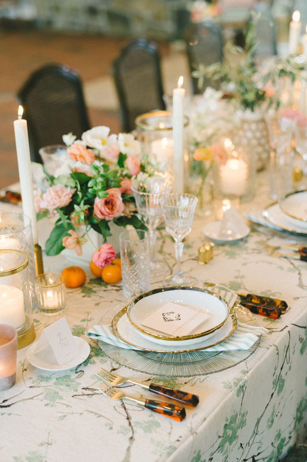 elegant citrus, gold, and green wedding place setting