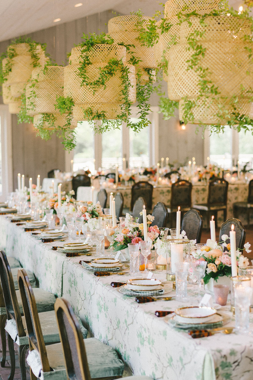 long elegant tables with citrus, green, and gold decorations