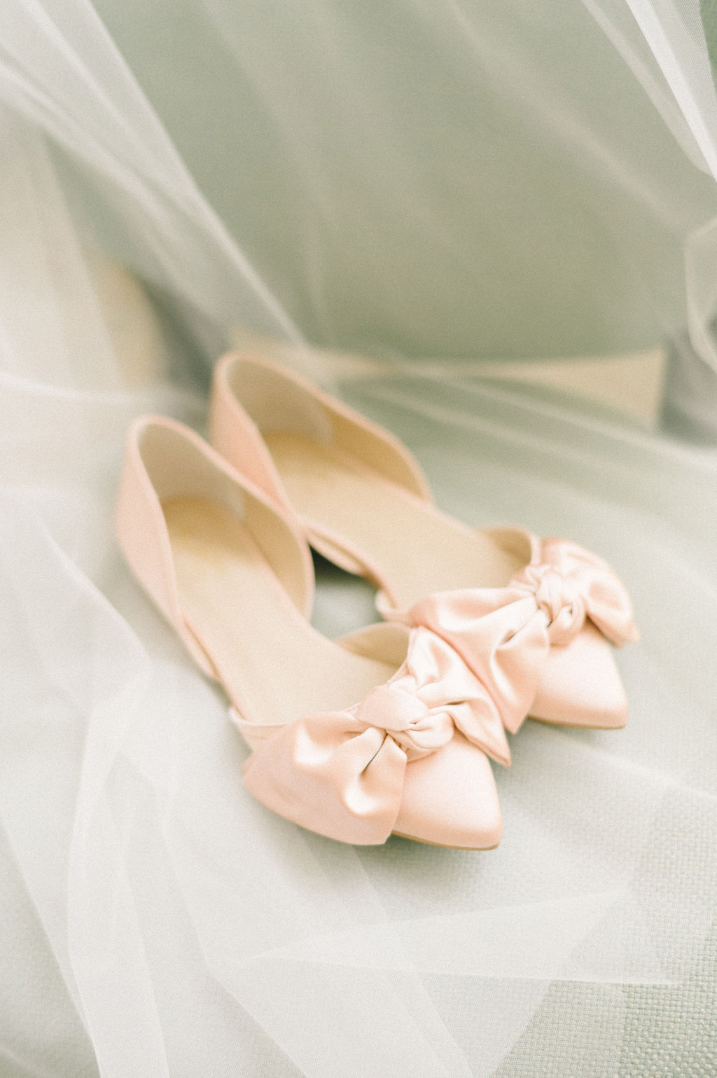 bride's pastel pink wedding shoes with bows