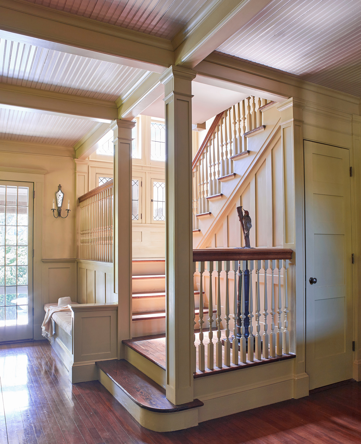 front hall with built-in bench