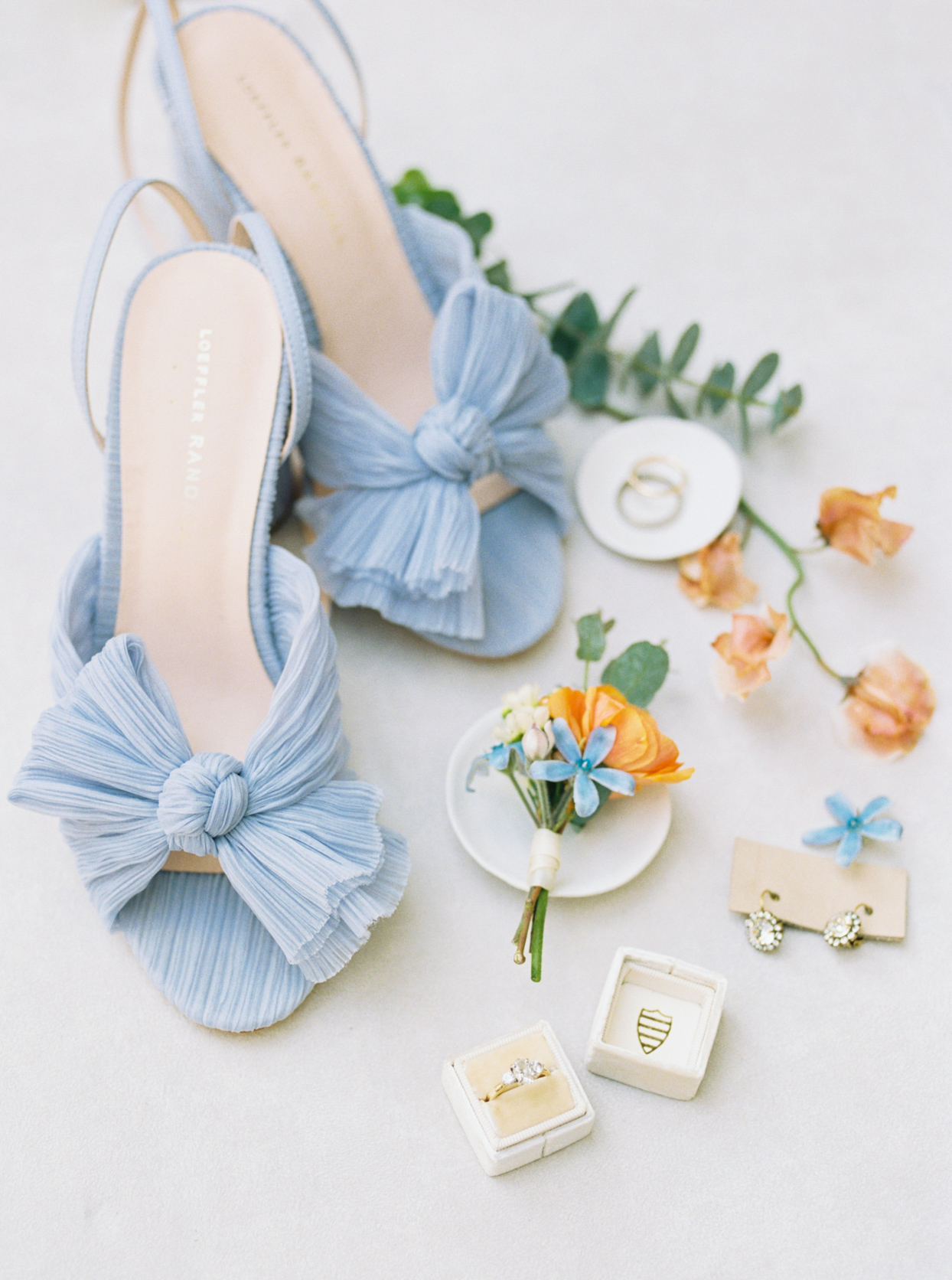 bride's pastel blue wedding shoes and accessories