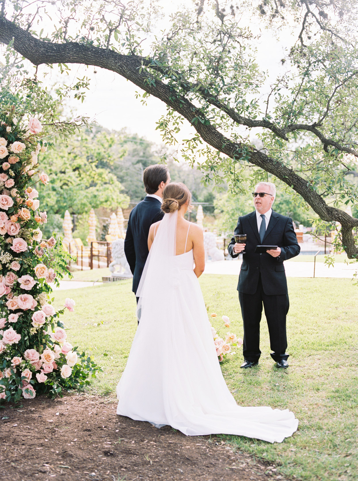 wedding couple standings outdoors for wedding ceremony