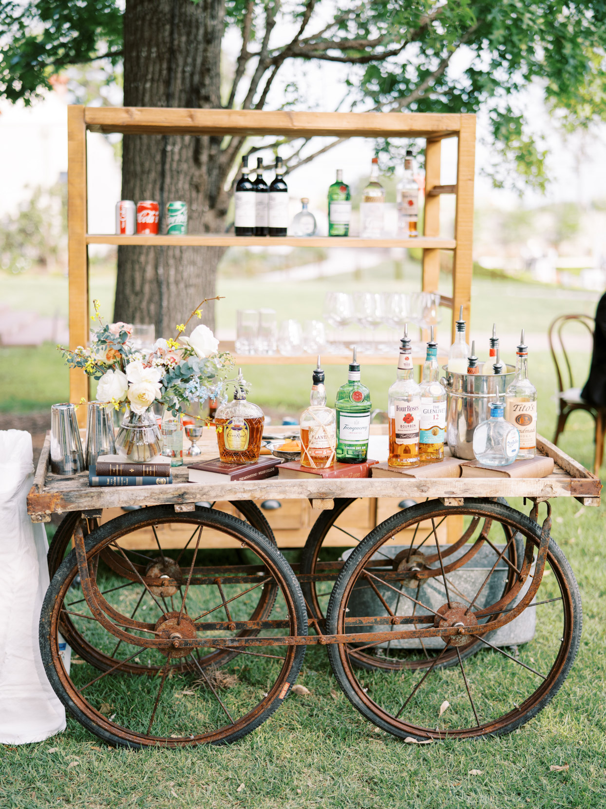 antique wedding cocktail cart with books and flower decorations