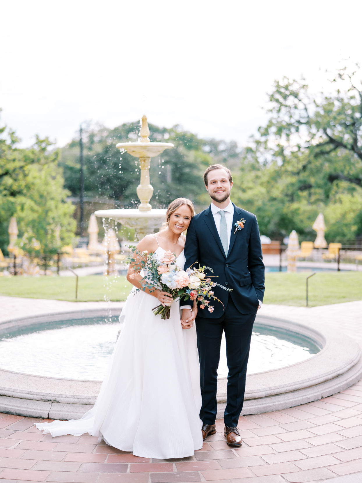 couple wedding portrait in front of fountain