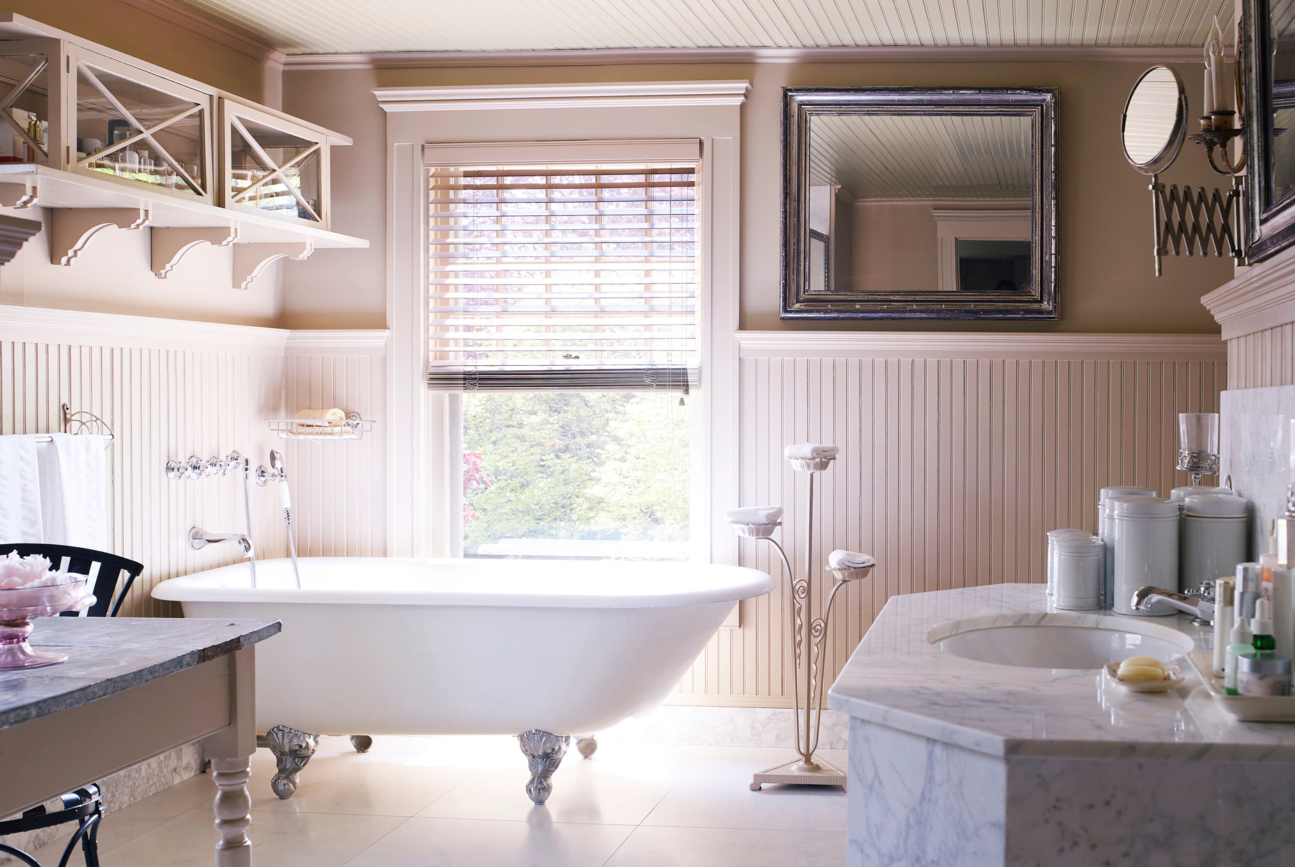 master bathroom with marble vanity and clawfoot tub