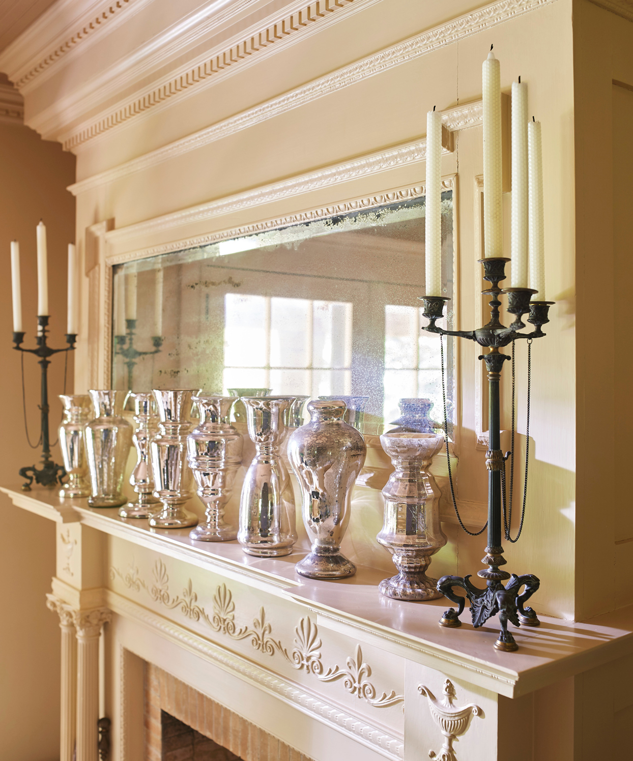 collection of mercury-glass vases line the living-room mantel