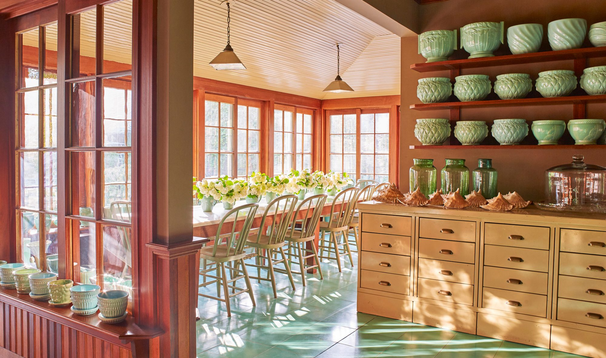 open porch dining area with teal-blue flooring