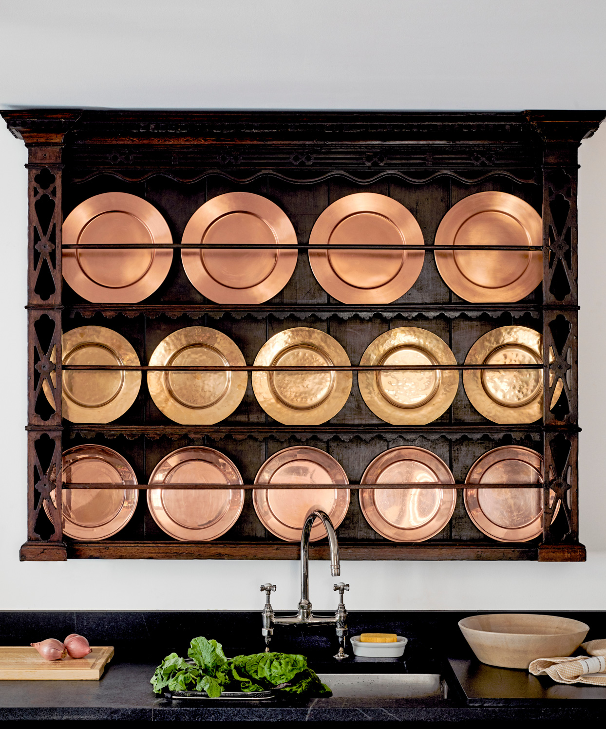 plate rack with antique copper dishes
