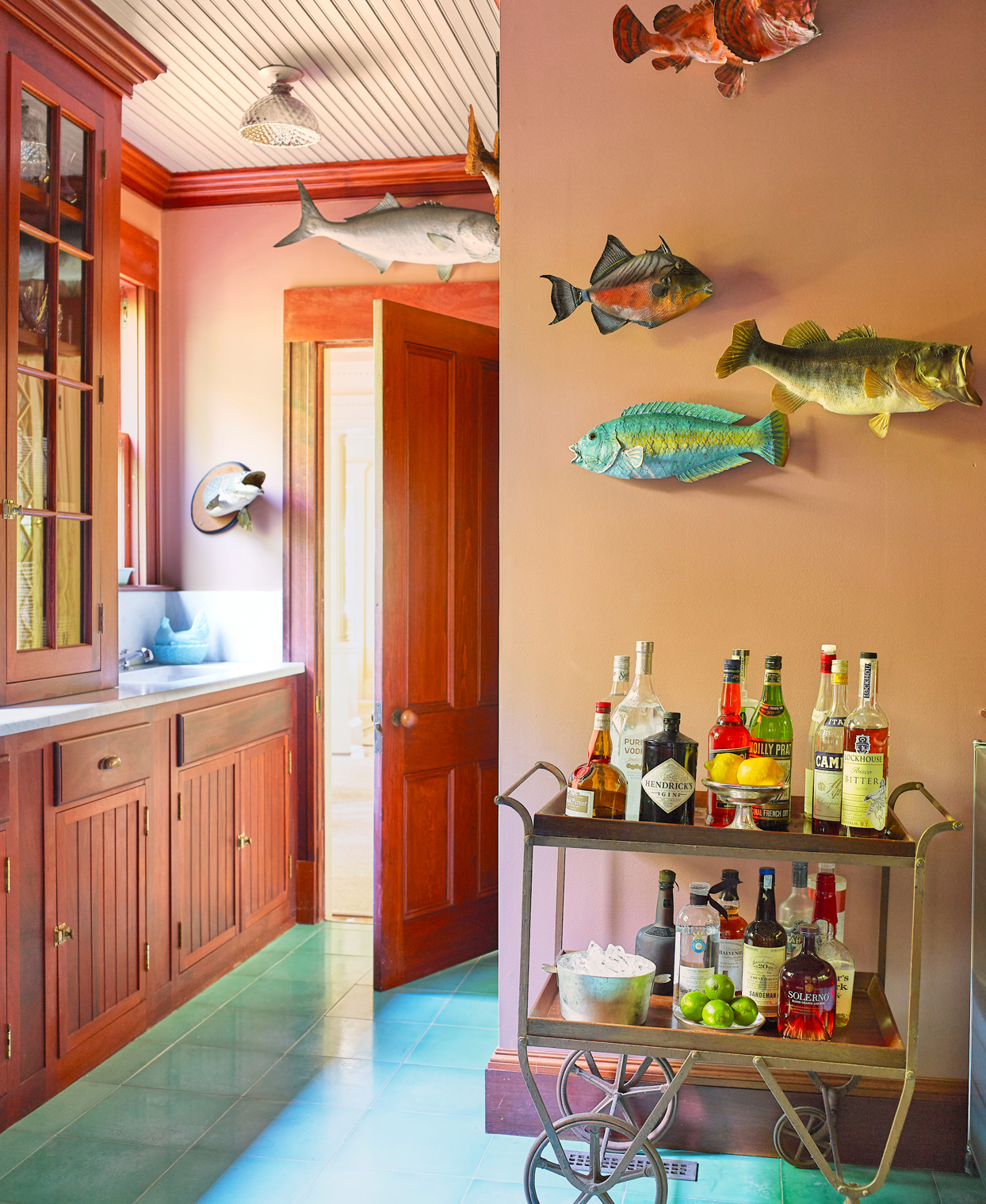 mounted taxidermy fish and antique bar cart
