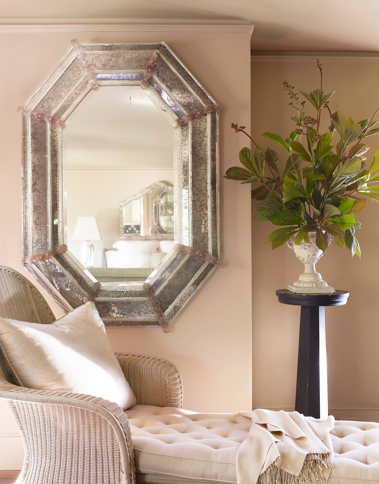antique wicker chaise and venetian mirror