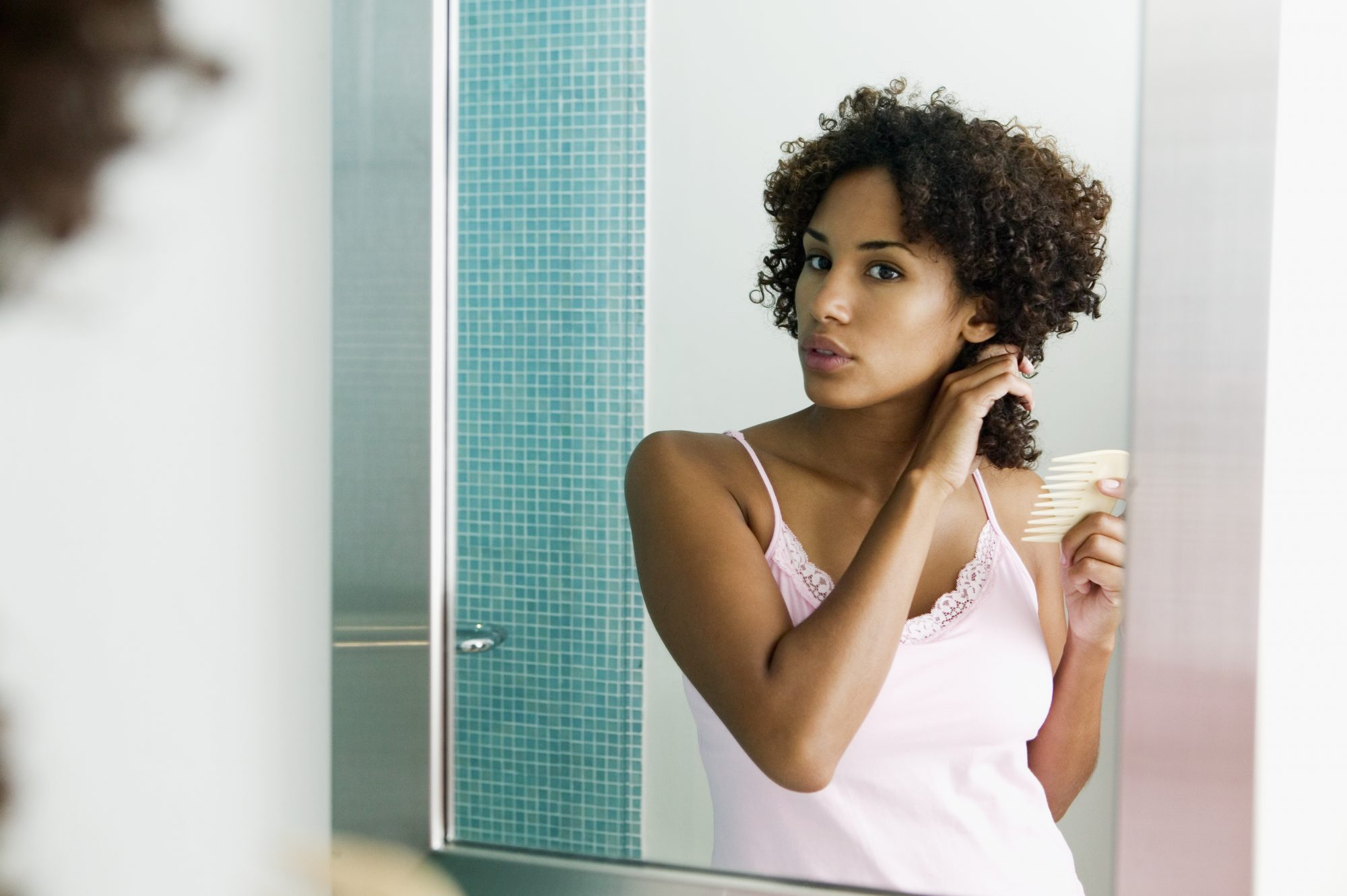woman combing hair with wide tooth comb