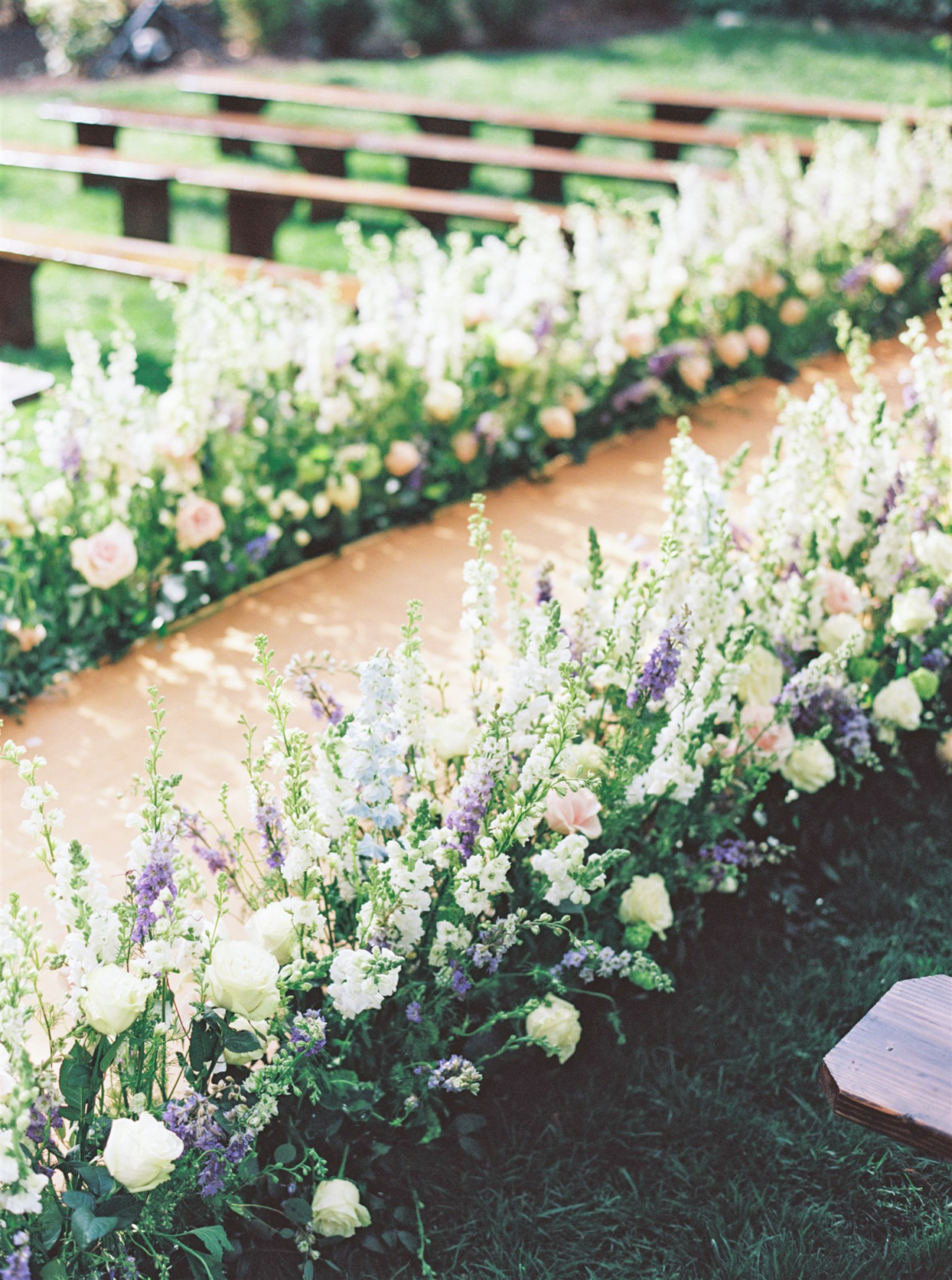 aisle of flowers at ceremony
