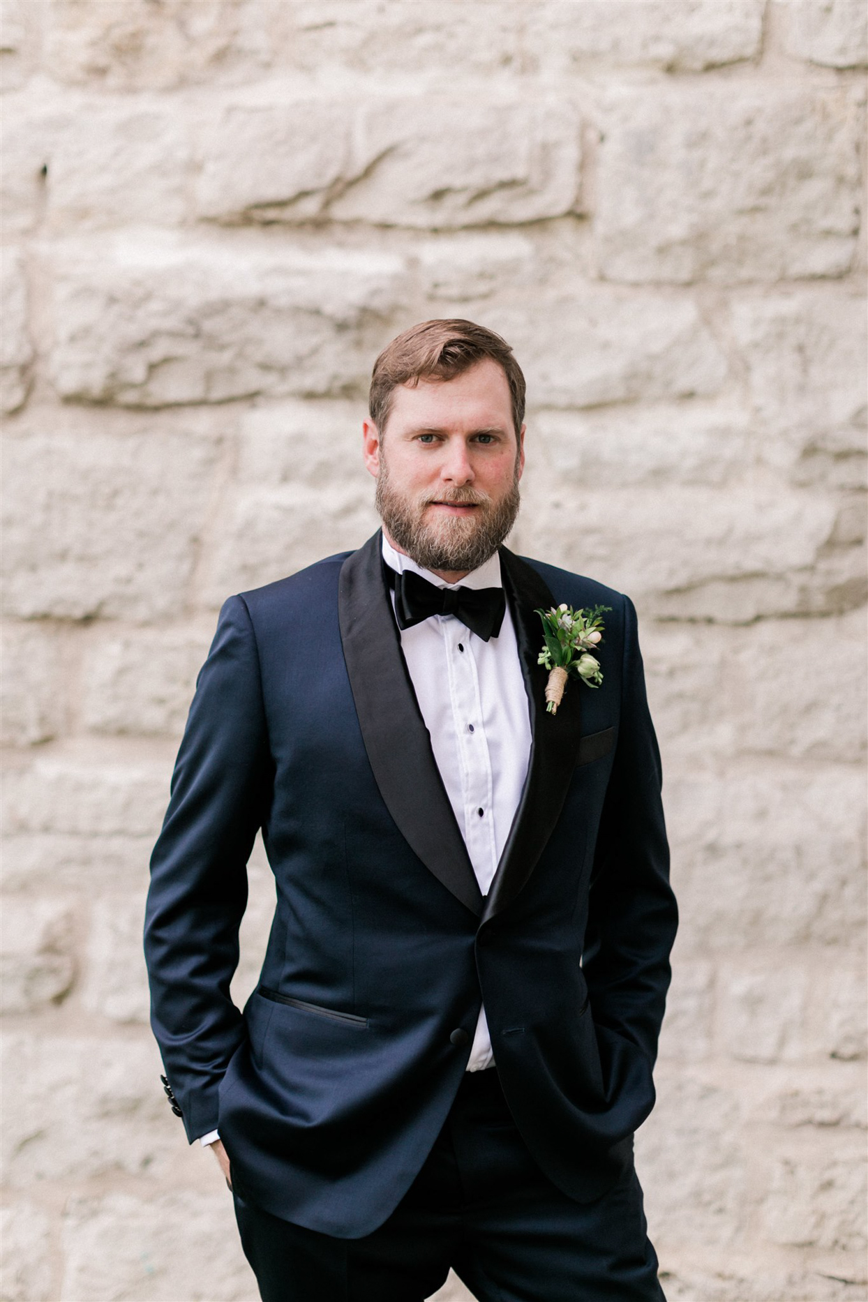 groom in navy suit with boutonniere