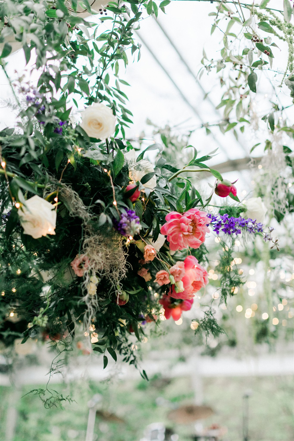 wedding reception flower chandeliers with string lights