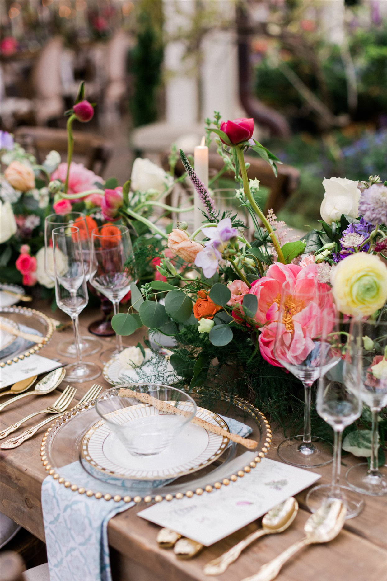 whimsical dinner table setting with gold accents