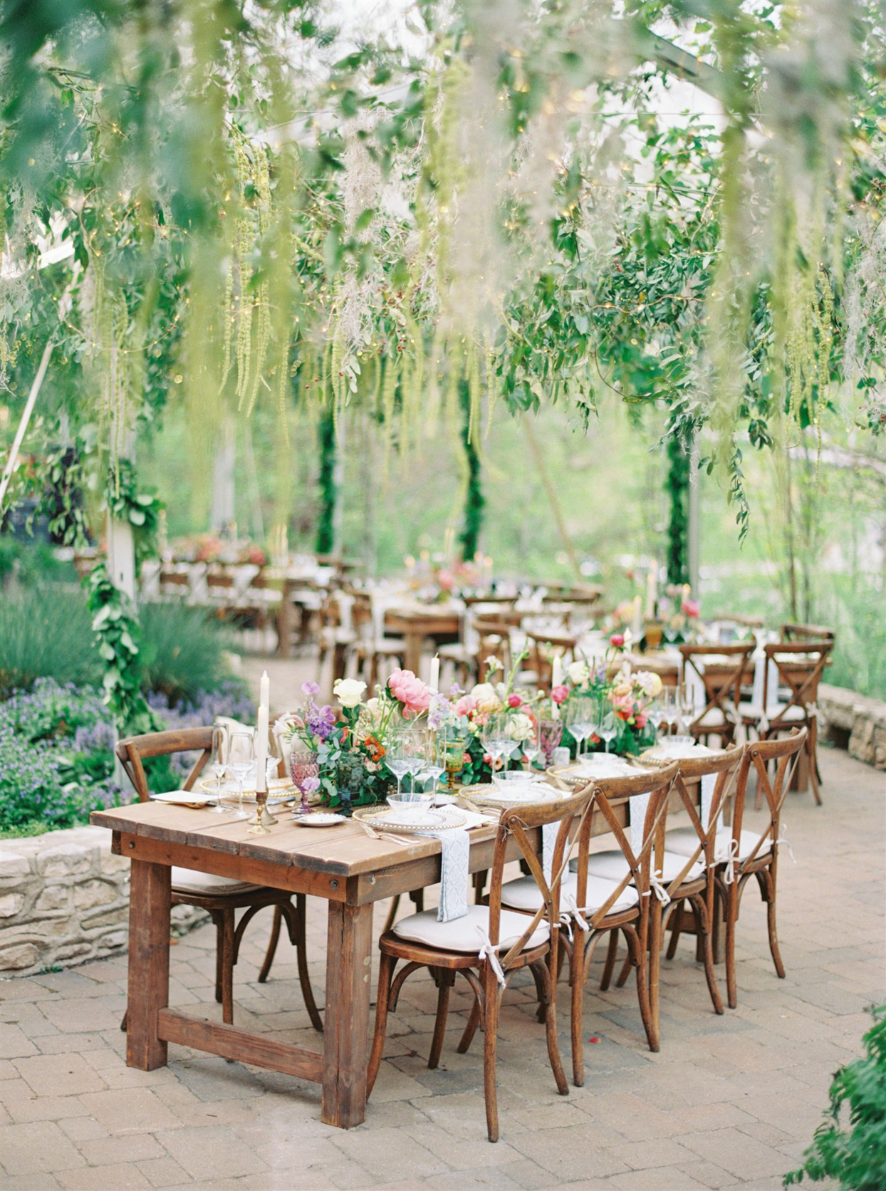 wooden reception tables with flowers and candles