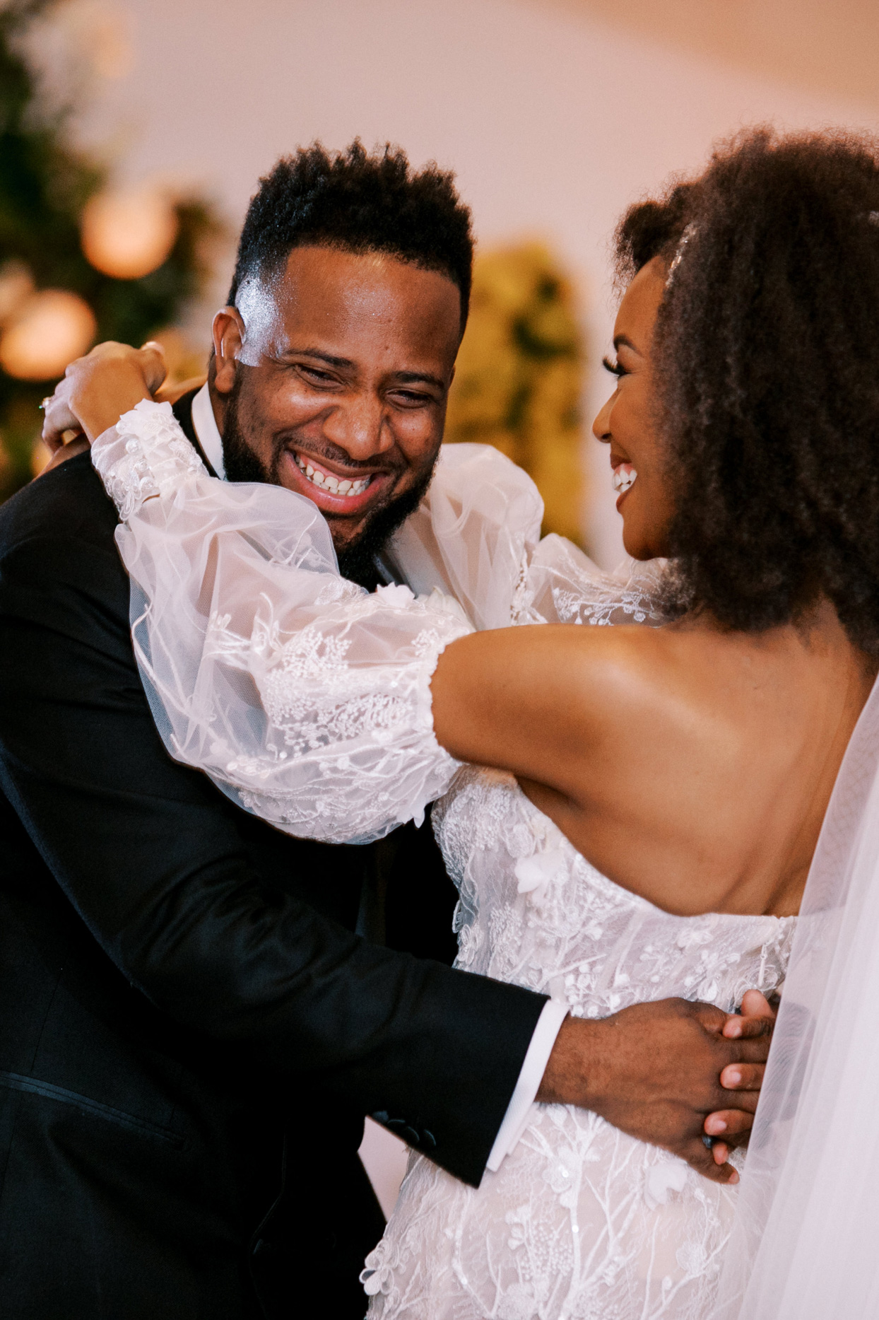 bride and groom smiling during first dance