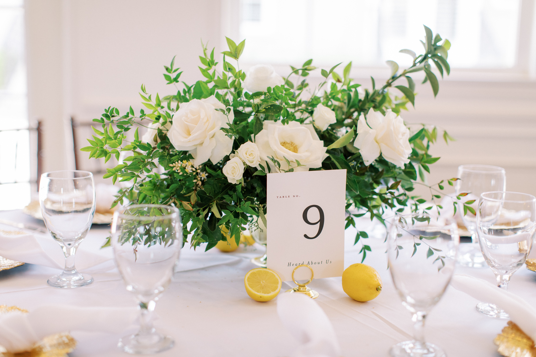 white floral wedding reception table centerpieces with yellow accents