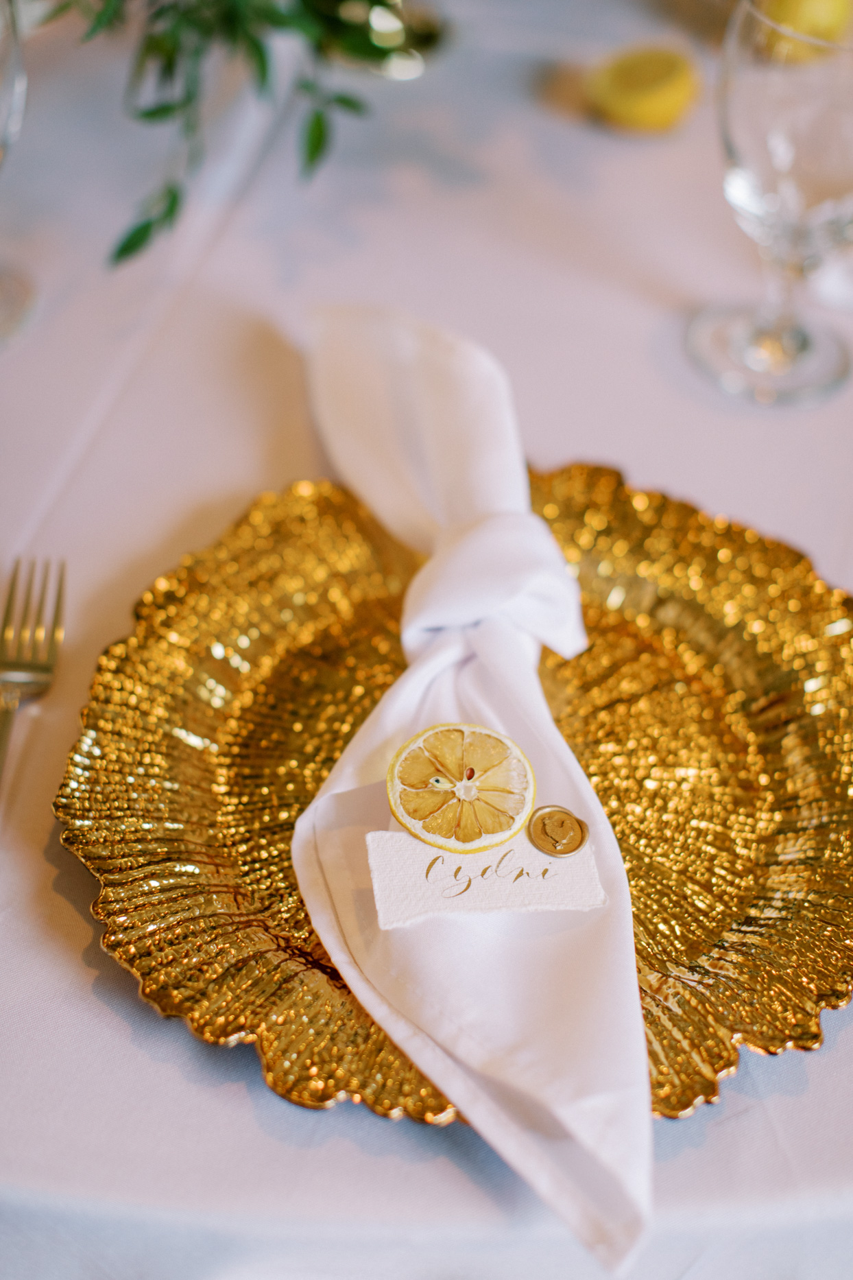 white and gold reception place settings