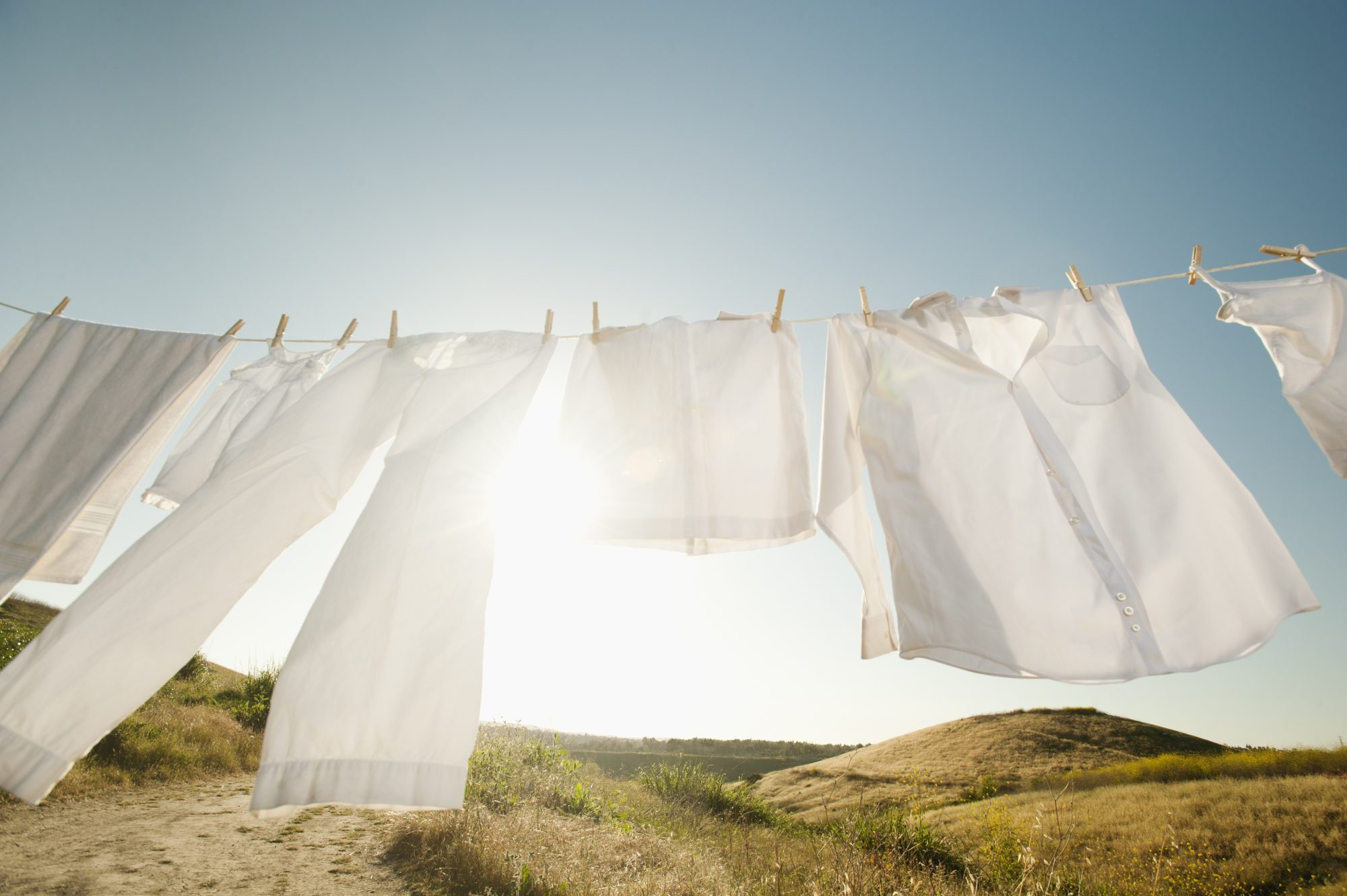 white clothes drying outdoors on clothesline