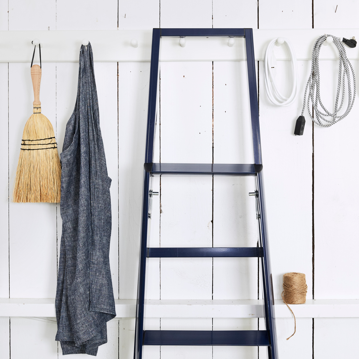 supply closet black ladder and duster
