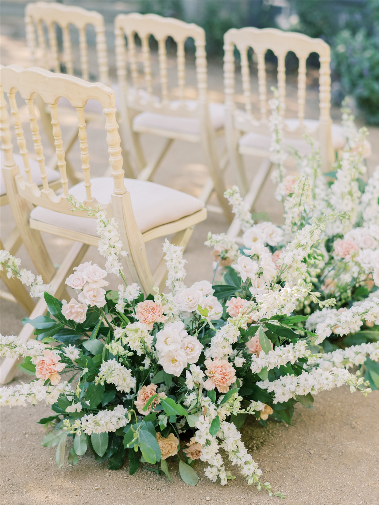 large white and pink floral wedding aisle decor