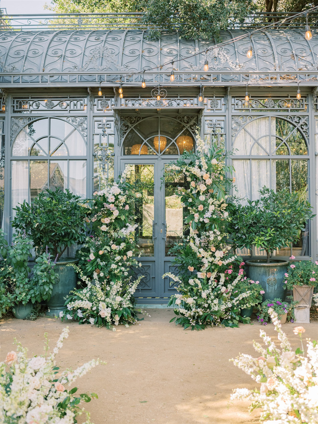 floral and greenery covered wedding ceremony set up