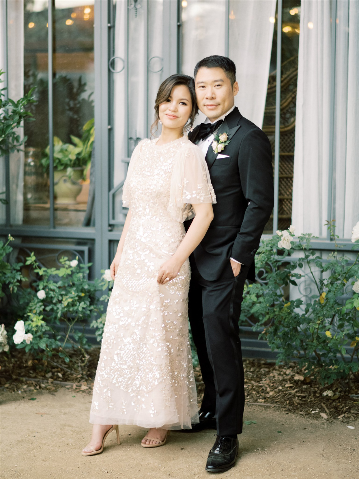 bride and groom wearing alternate reception outfits