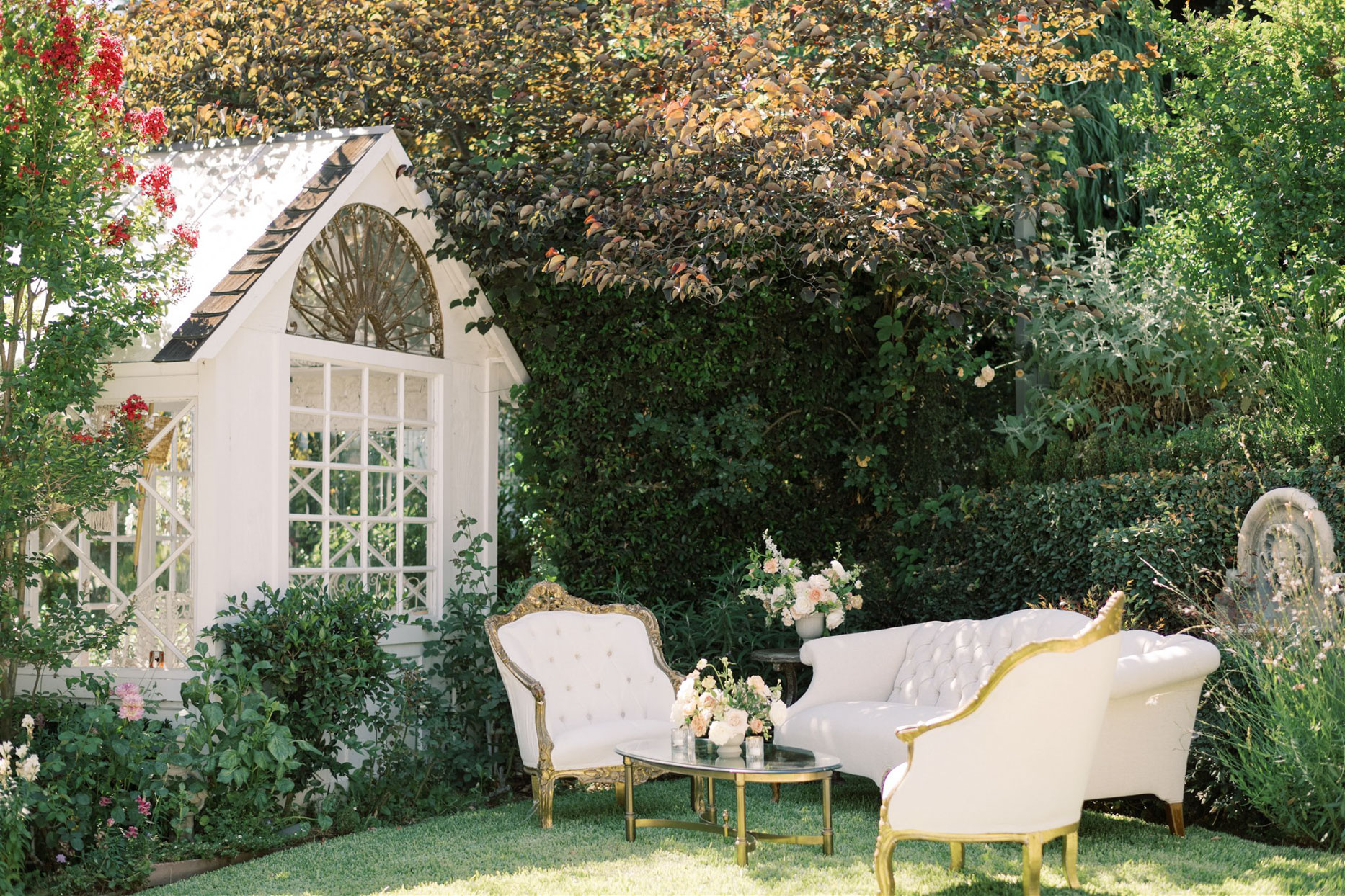 white and gold accent wedding lounge outside