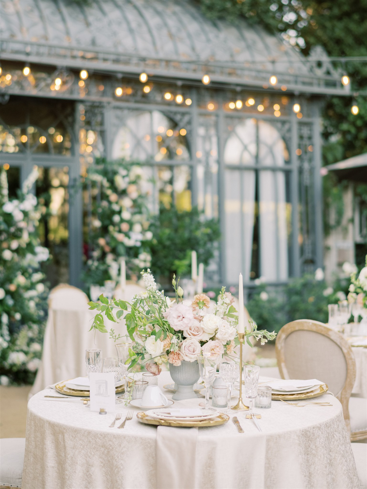 round white linen covered reception tables with floral centerpieces