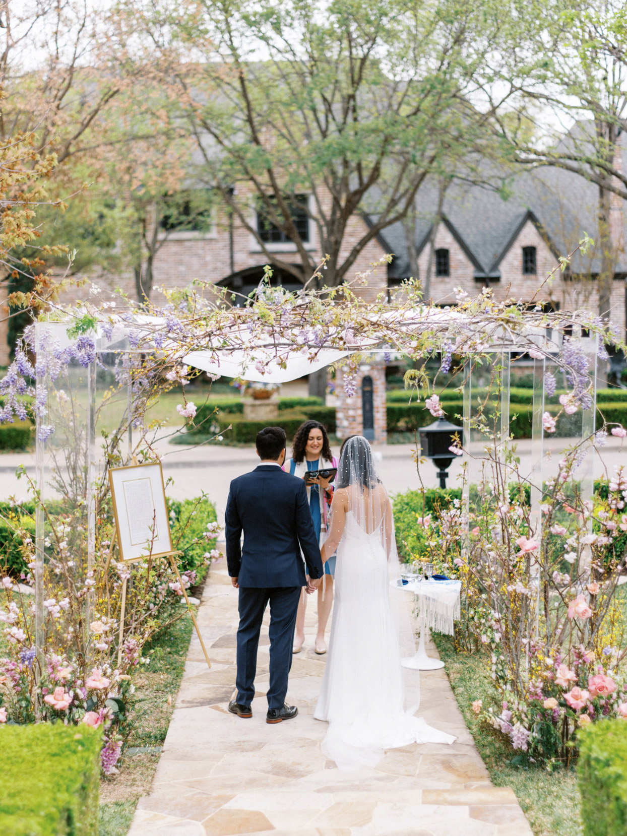 bride and groom during front yard wedding ceremony