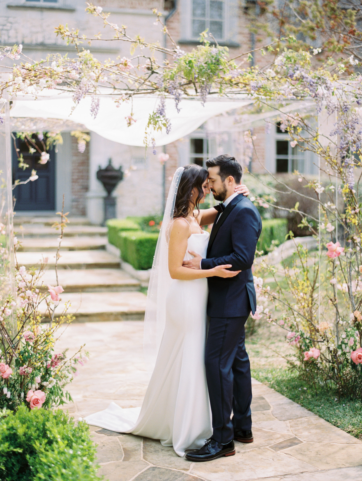 bride and groom share first look under chuppah