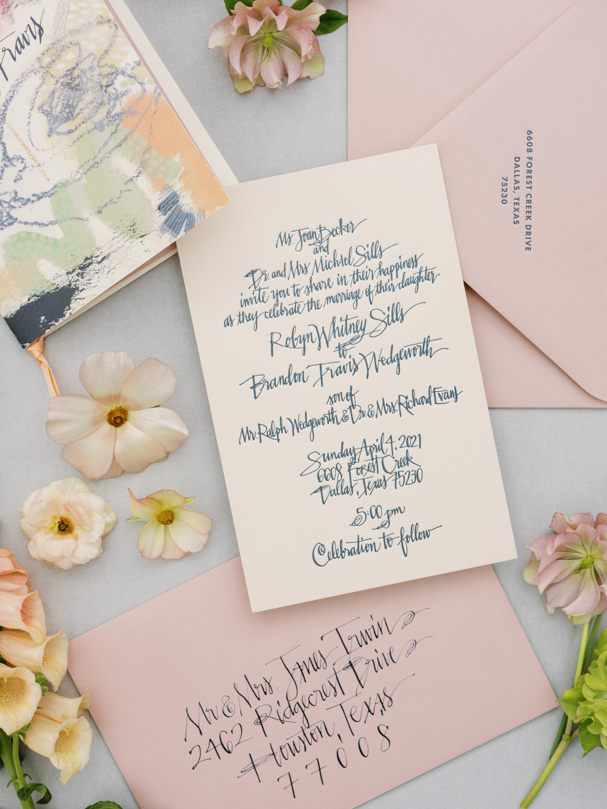 blush pink and navy colored wedding invitation suite