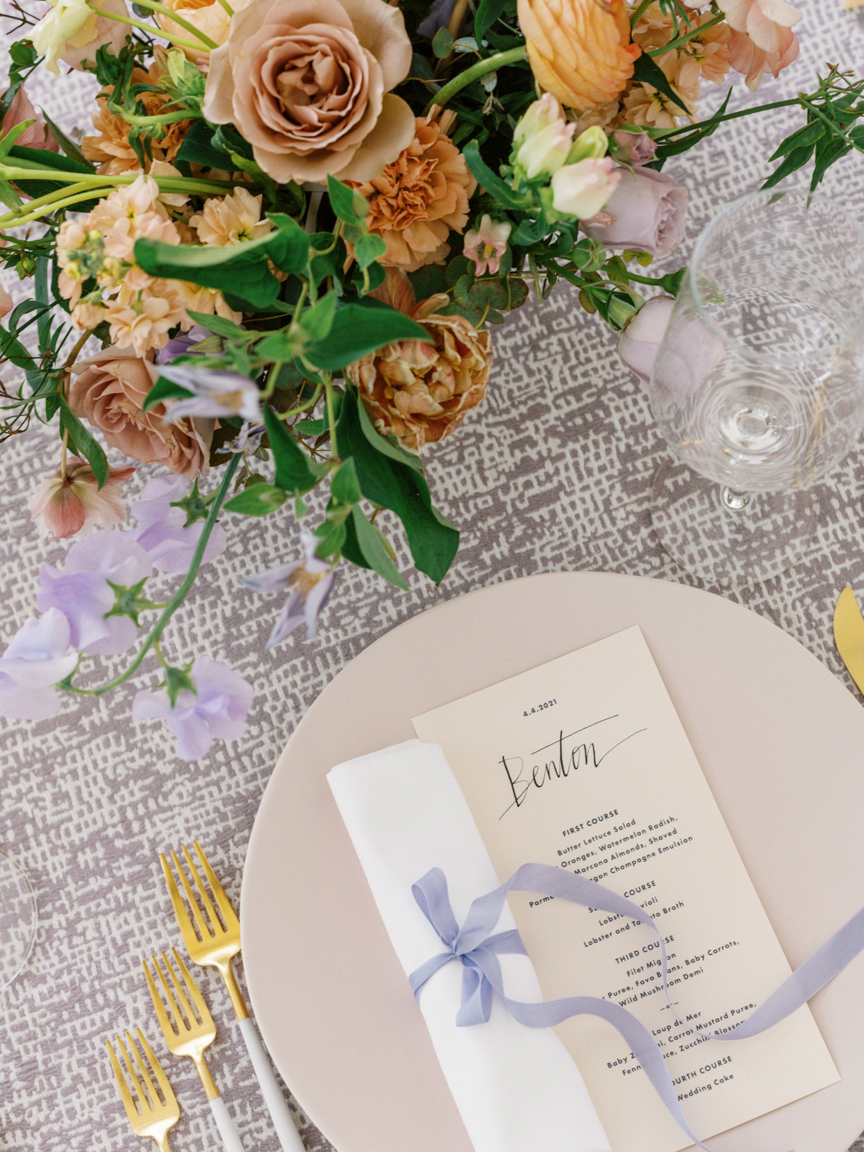 purple and gold reception table place settings