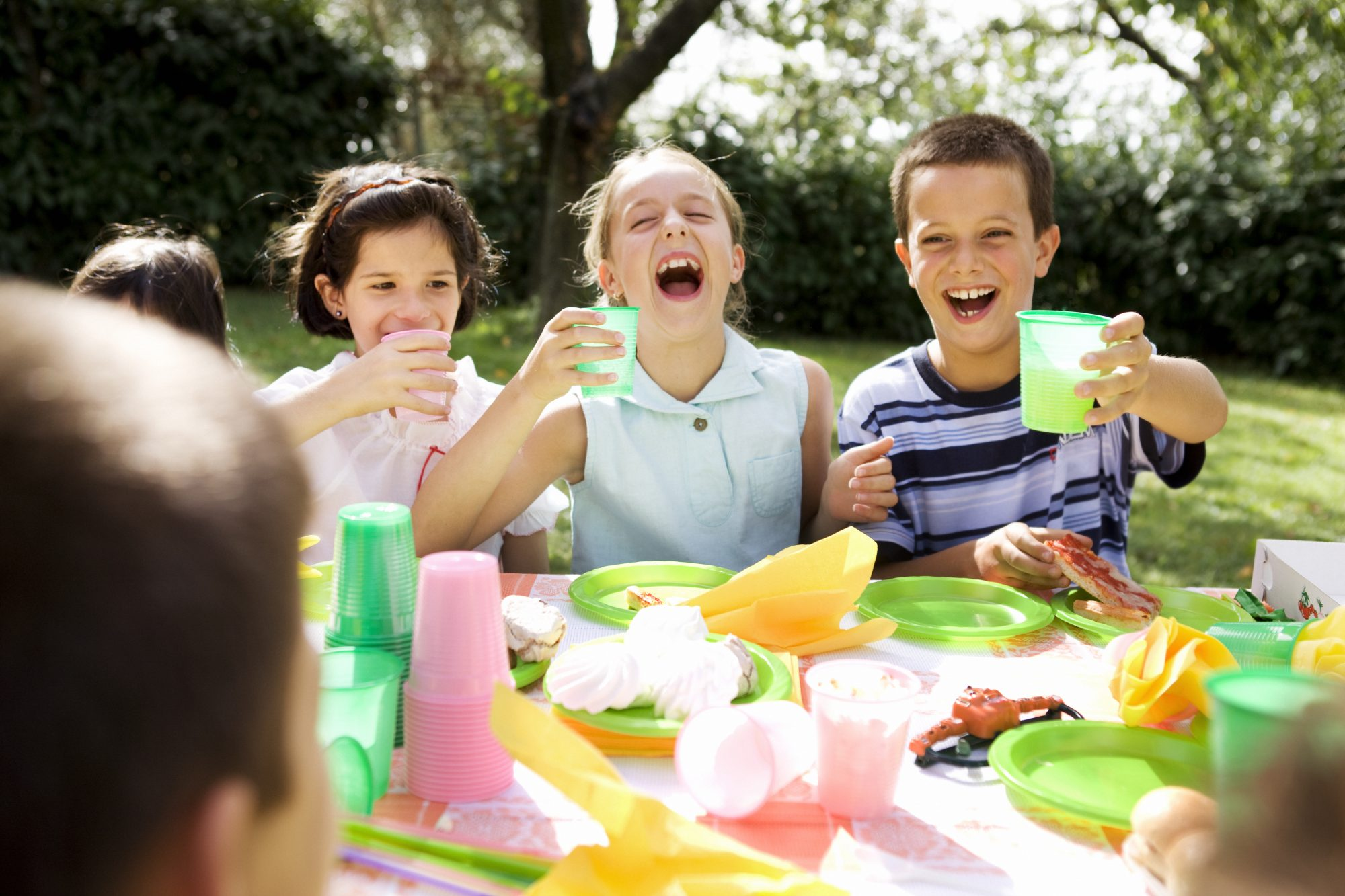 kids having party at table outdoors