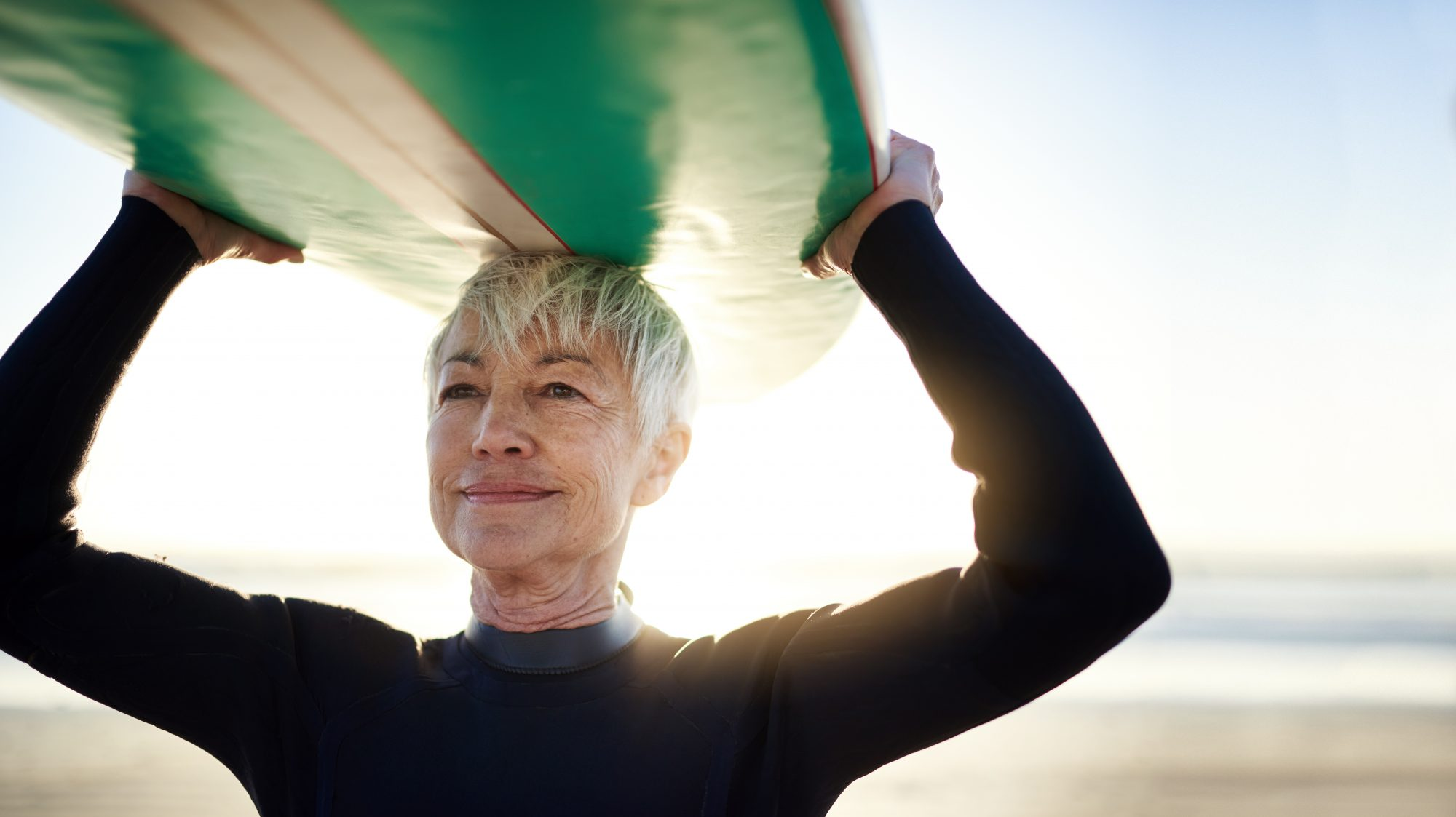 retired aged woman out surfing