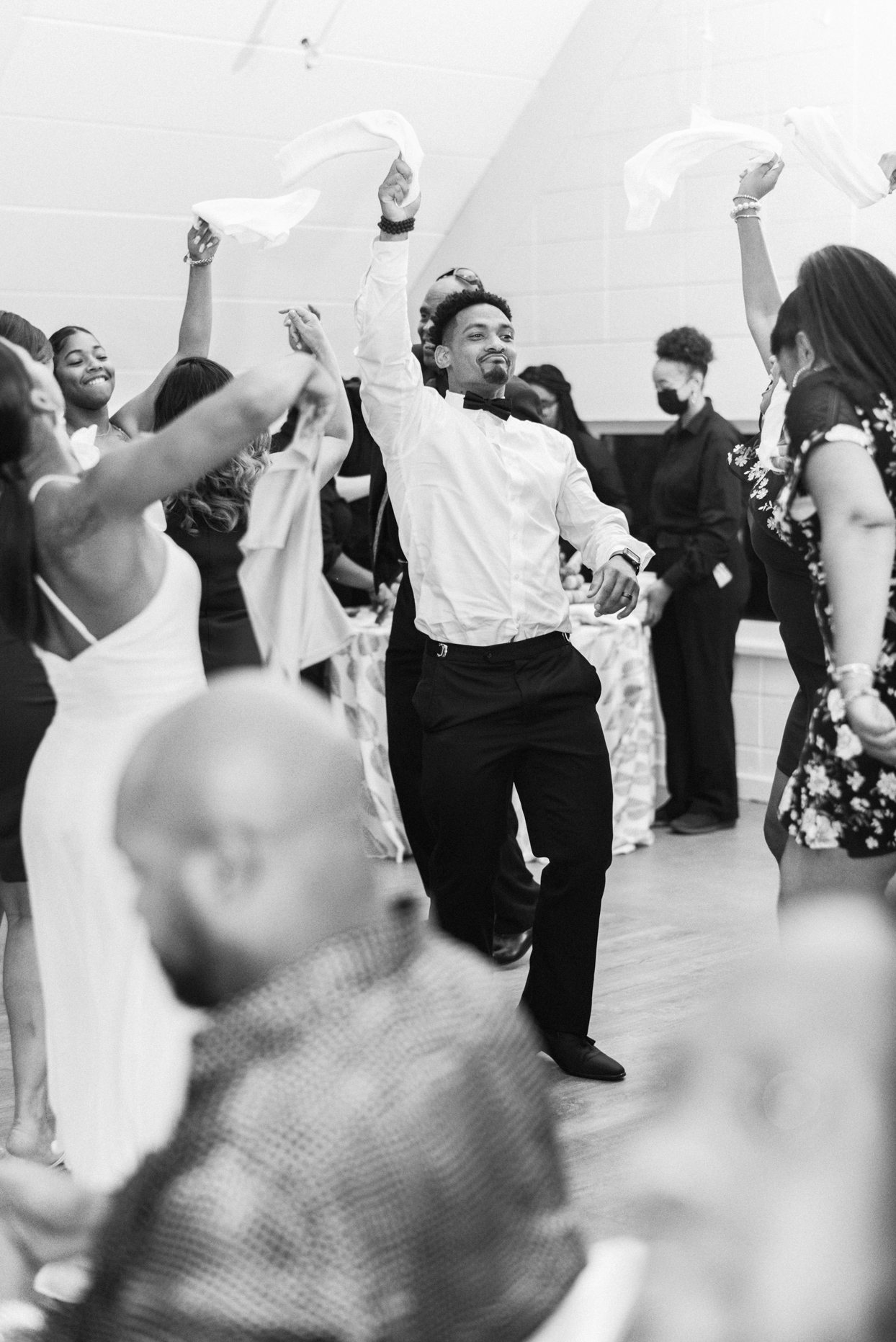 groom dancing in the middle of guests on reception dance floor