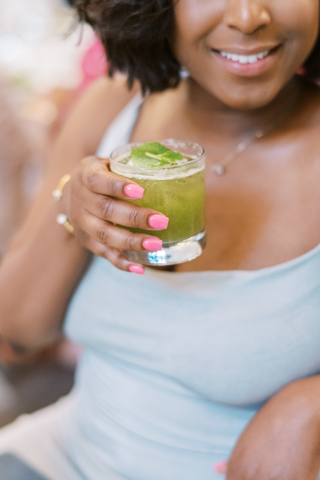 guest drinking green cocktail during wedding reception