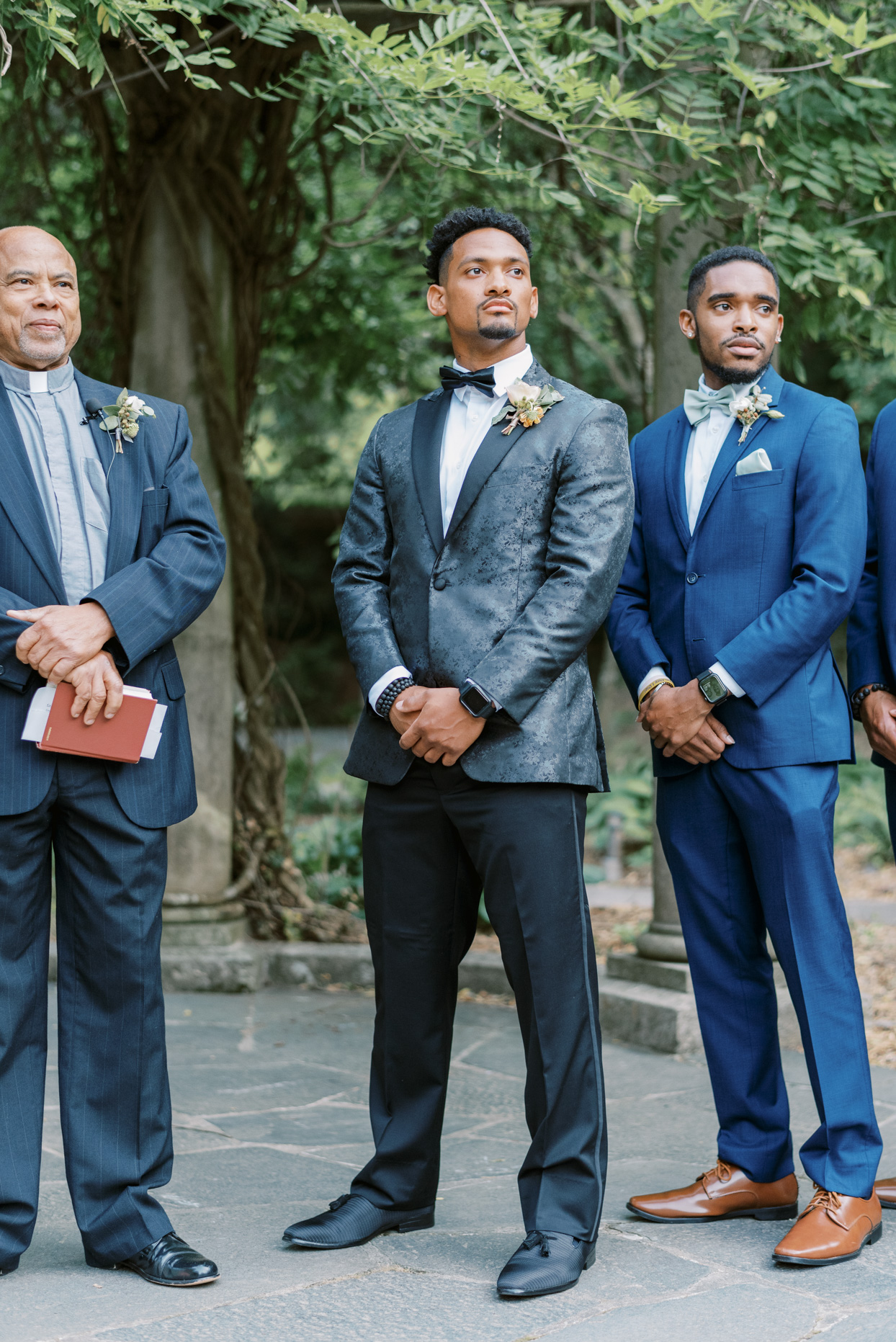 groom during processional standing with groomsmen