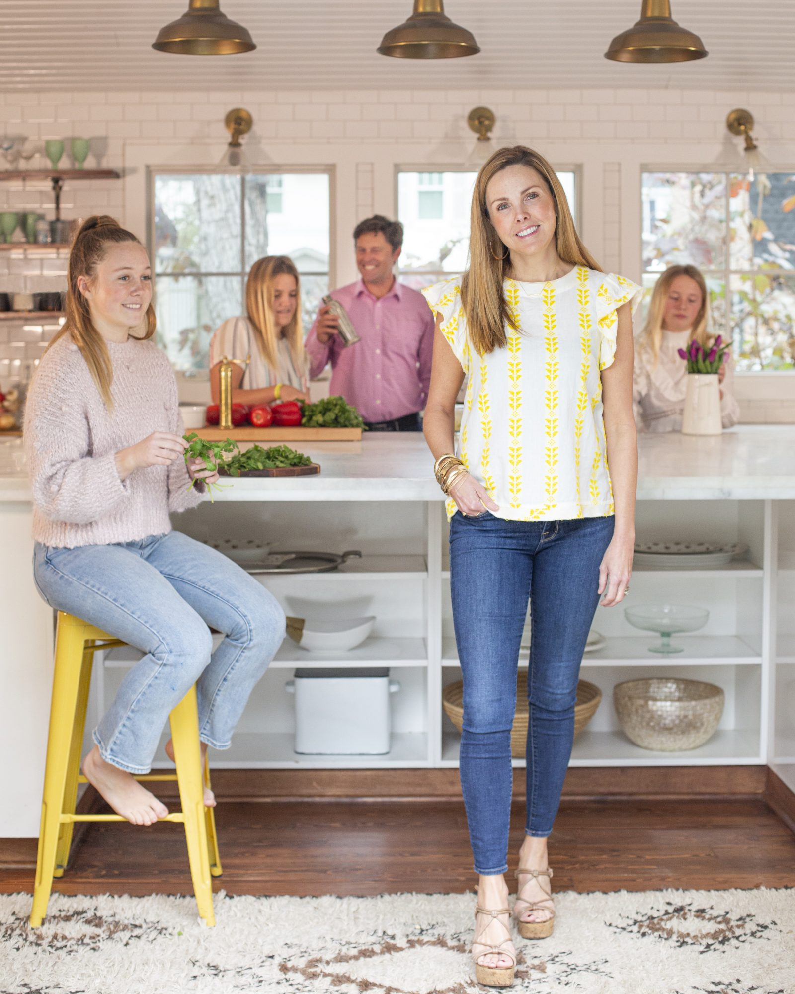 portrait of carrie morey in kitchen with family